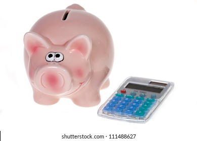 Smiling Pink piggy bank and a modern pocket calculator isolated on white background
