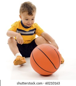 Smiling playful little boy with basketball