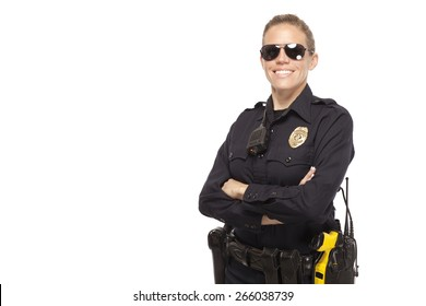Smiling police officer in sunglasses posing with hands crossed against white background