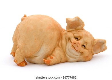 Smiling porcelain pig in prone position piggy bank over white