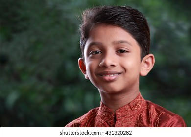 Smiling portrait of an Indian Boy in outdoor