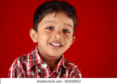 Smiling portrait of a small in a red background
