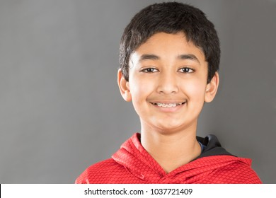 Smiling Portrait of a Young Boy Displaying His Braces