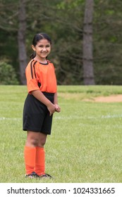 Smiling Portrait of a Young Soccer Player in a Field
