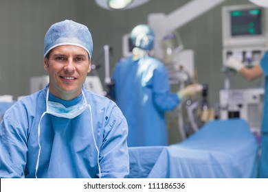 Smiling practitioner in operating theater