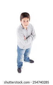 Smiling preteen boy seen from above standing isolated on a white background