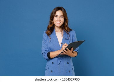 Smiling pretty beautiful attractive young brunette woman 20s wearing basic jacket hold clipboard with papers document writing looking camera isolated on bright blue colour background studio portrait - Shutterstock ID 1854527950