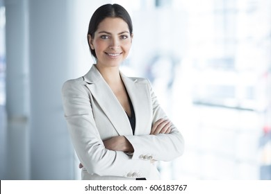 Smiling Pretty Business Woman With Arms Crossed