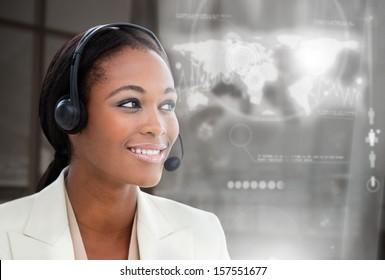 Smiling pretty businesswoman using futuristic interface hologram on dark background
