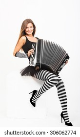 Smiling pretty girl playing Russian bayan (button accordion)