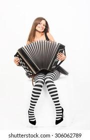 Smiling pretty girl playing the Russian bayan (button accordion)