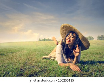 smiling pretty woman lying on the grass