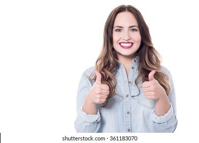Smiling pretty woman showing double thumbs up