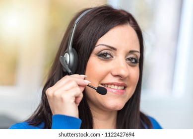 Smiling pretty woman using an headset