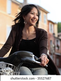 Smiling pretty young woman on a bike
