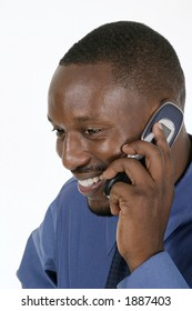 Smiling professional, business man, teacher, or medical doctor smiling and talking on a cellphone.