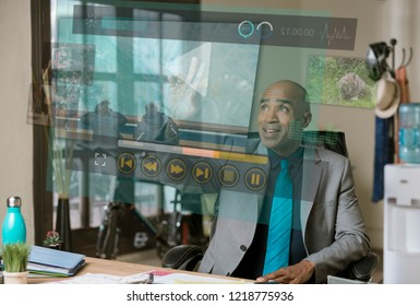 Smiling professional man working on a futuristic video screen