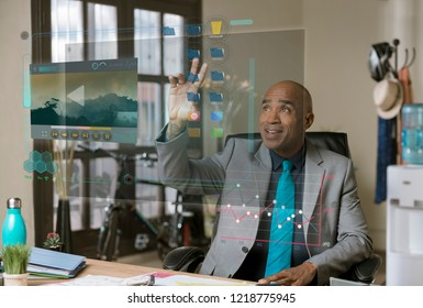 Smiling professional man working on a futuristic computer desktop screen