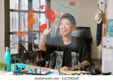 Smiling professional woman working on a futuristic screen in her office