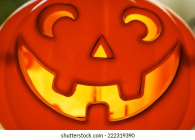 Smiling pumpkin head with back light