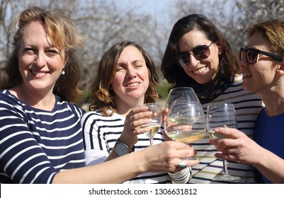smiling real mature women is holding champagne glasses
