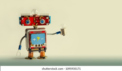 Smiling red robot with light bulb in hand. Kind toy character on a gradient beige background. Copy space.