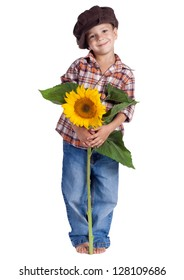 Smiling rural boy standing with sunflower, isolated on white