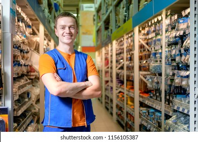 Smiling salesman at construction super store