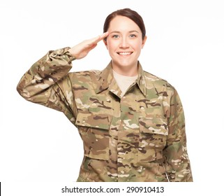 Smiling and saluting female Army soldier wearing multicam camouflage on white background.
