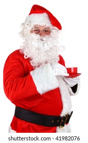 Smiling Santa Claus with glasses drinking a coffee from a cup on a white background
