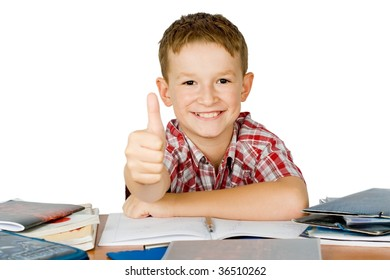 Smiling school boy with thumbs up isolated on white