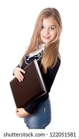 Smiling school girl standing with blank book in hands, isolated on white