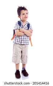 Smiling school kid standing with arms crossed against white background