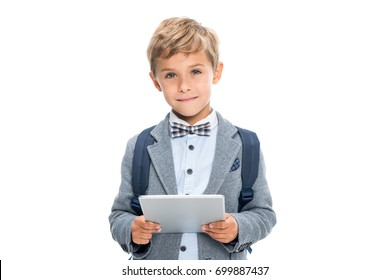smiling schoolboy with digital tablet isolated on white