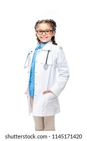 smiling schoolchild in costume of doctor looking at camera isolated on white