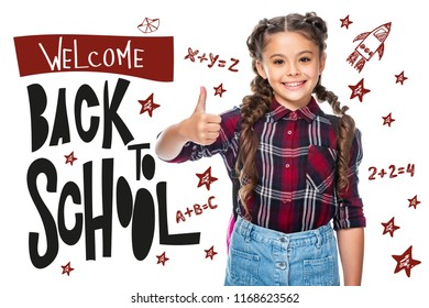 """smiling schoolchild showing thumb up isolated on white, with """"welcome back to school"""" lettering"""
