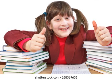 smiling schoolgirl did schoolwork and shows thumb-up