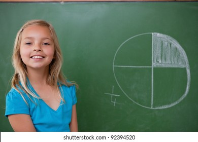Smiling schoolgirl learning the divisions on a blackground