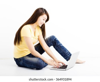 Smiling seated young woman with laptop