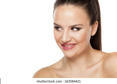 smiling seductive young woman looking aside