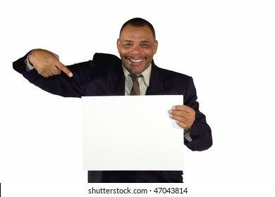 a smiling senior African-American businessman pointing at a picture board with copy space, isolated on white background