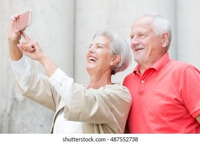 Smiling senior couple make a selfie