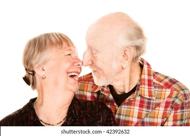 Smiling senior couple touching their noses together