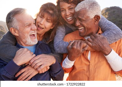 Smiling Senior Friends Having Fun Walking In Countryside Together - Shutterstock ID 1722922822