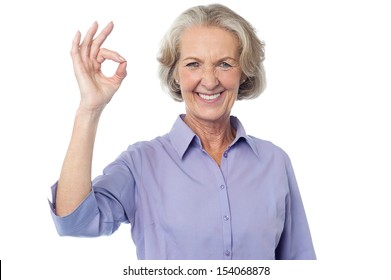 Smiling senior lady gesturing perfect sign
