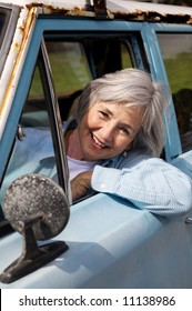 Smiling senior taking a cruise in the old rustbucket