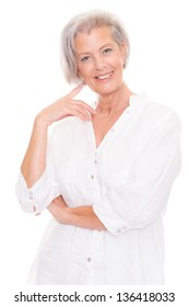 Smiling senior woman in front of white background