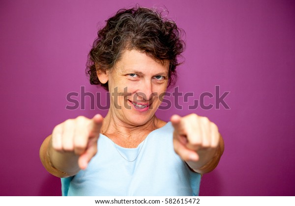 Smiling senior woman reaching arms to camera