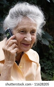 Smiling senior woman talking on sell phone