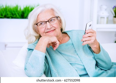 Smiling senior woman talking on her cell phone. Beauty, fashion. Happy retirement.